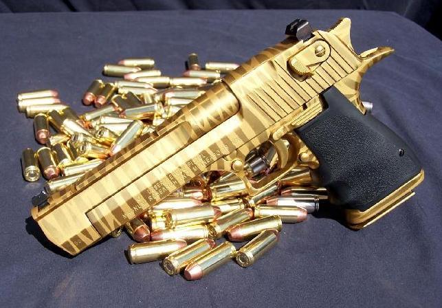 aa-gun-gold-color-w-bullets-beside-it