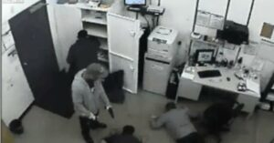 [VIDEO] Employees robbed at gunpoint, what would you have done?