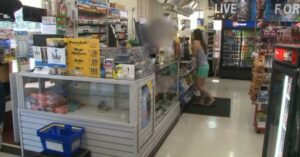 [VIDEO] Robber Enters Store, Points Gun At Clerk, Owner Points Own Gun At Robber, Robber Loses