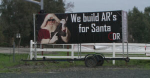 Holiday Gun Range Billboard Causes a Stir Among Residents