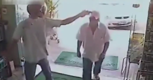 [VIDEO] Store Owner Doesn't Have Time For Armed Robber's Games