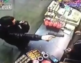[VIDEO] Don't Have Your Own Gun? Just Take It From The Armed Robber