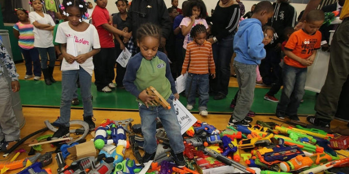 Kids play with pretend guns