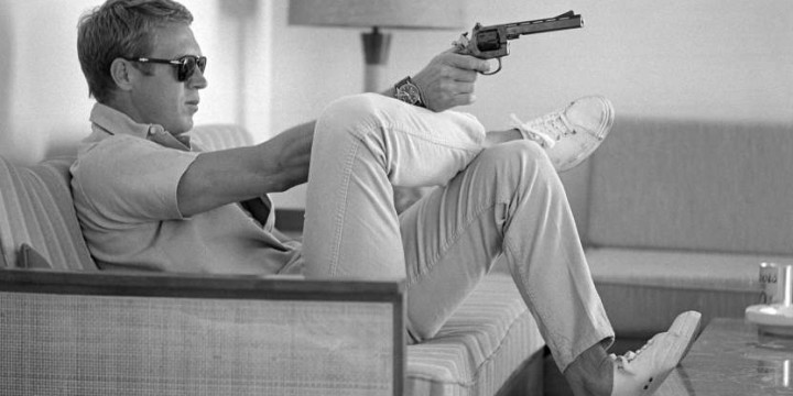 At his bungalow in Palm Springs Steve McQueen practices his aim before…