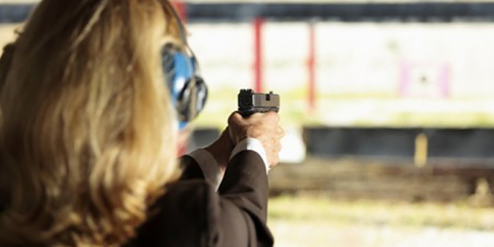 Woman shooting 450x299