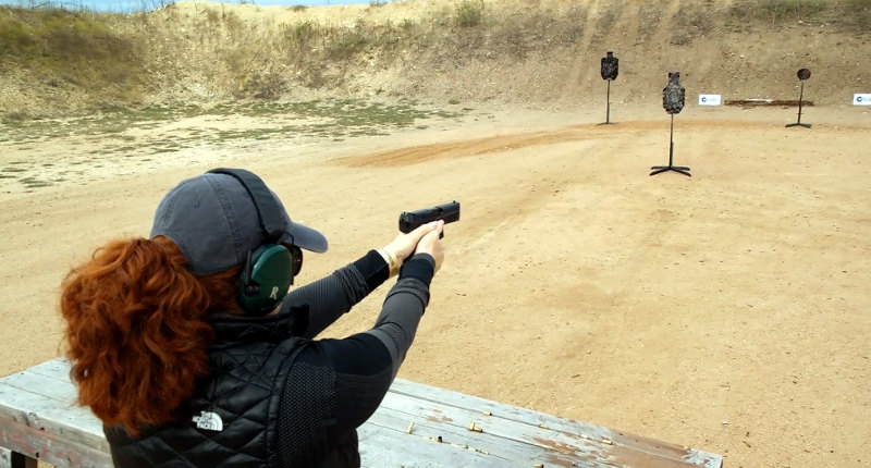Screenshot from Texas Firearms Festival - Christen tests out the HK P30SK VP9 and FNH FNS9C FNS9