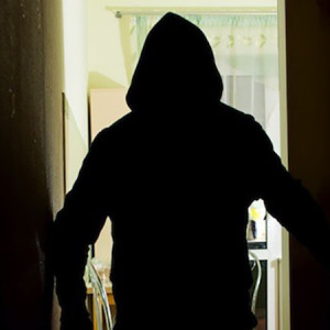 An intruder man with a knife in silhouette
