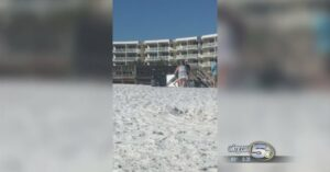 [VIDEO] Guy With Umbrella Takes Out Guy With Gun On Beach