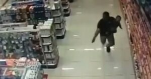*WATCH* Two Armed Robbers Dead After Father, While Holding Infant Son, Shoots After Having Gun Pointed At Him