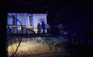 A robbery at a home led to a fight and shootout that killed one man and injured another, investigators with the Adams County Sheriff's Department said. Deputies received a call at 12:20 a.m. Thursday about an armed robbery on Proby Road. When the deputies arrived in the area, they stopped a vehicle that was driving away from the scene, authorities said. The driver, Marlon Dean, 40, had a handgun between the driver's seat and the center console, investigators said. Dean was detained while deputies continued to the home on Proby Road, authorities said.