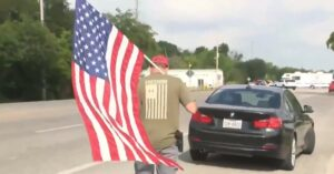 [WATCH] Man Shows Up Near Texas School Shooting Scene With Gun And American Flag
