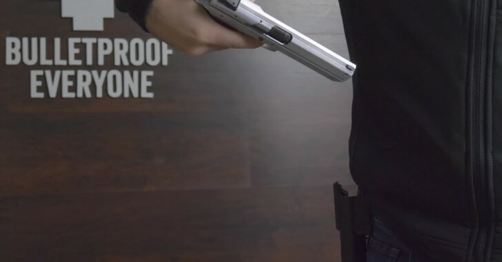 Watch This Guy Literally Stand Behind His Product: The Bulletproof Jacket. Yes, He Shoots Himself.