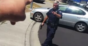 [WATCH] Cop Draws Gun On Man Who Was Filming Him In Neighborhood