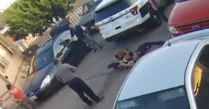 [WATCH] A Bunch Of Idiots Watch On As Officer Fights For His Life Against Violent Felon
