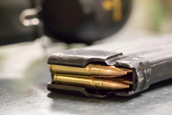 Machine gun magazine with bullets