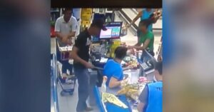 [VIDEO] Armed Man In Line Acts Quickly When Man In Front Of Him Puts Knife To Cashier's Back