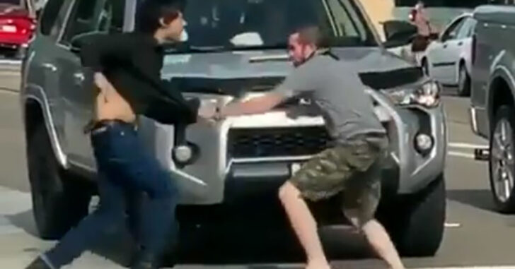 [VIDEO] Man Backed Up Into Car By Aggressor, Aggressor Knocked Out During Ensuing Fight